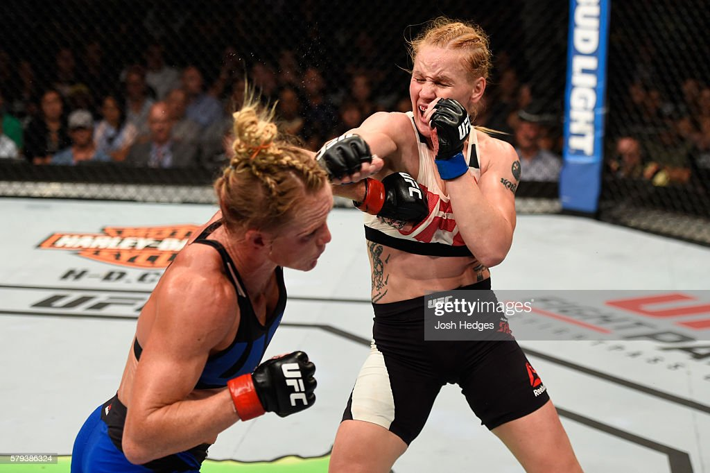 Holly Holm punches Valentina Shevchenko of Kyrgyzstan in their women's bantamweight bout during the UFC Fight Night event at the United Center on July 23, 2016 in Chicago, Illinois.