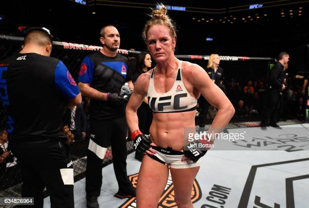 Holly Holm reacts to her loss to Germaine de Randamie of The Netherlands in their women's featherweight championship bout during the UFC 208 event...