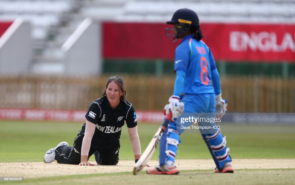Holly Huddlestone of New Zealand lies on the ground alongside Ekta Bisht of India during the ICC Women's World Cup warm up match between India and New Zealand at The County Ground on June 19, 2017 in Derby, England.
