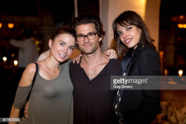 Holly Huebner Johnny Whitworth and Eva Dolezalva attend 'Carte Blanche' Cast Party at Chateau Marmont on August 2 2017 in Los Angeles CA