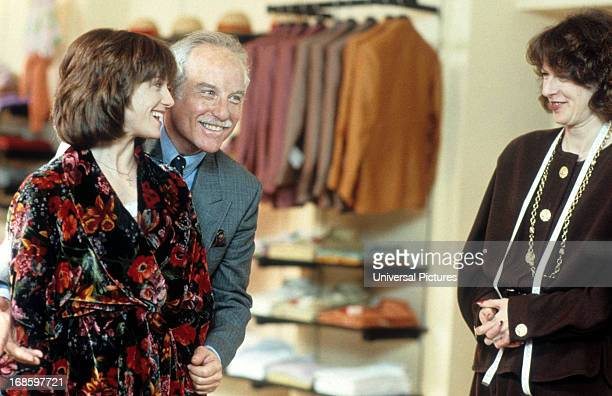 Holly Hunter tries out dress in front of Richard Dreyfuss and Laura San Giacomo in a scene from the film 'Once Around' 1991