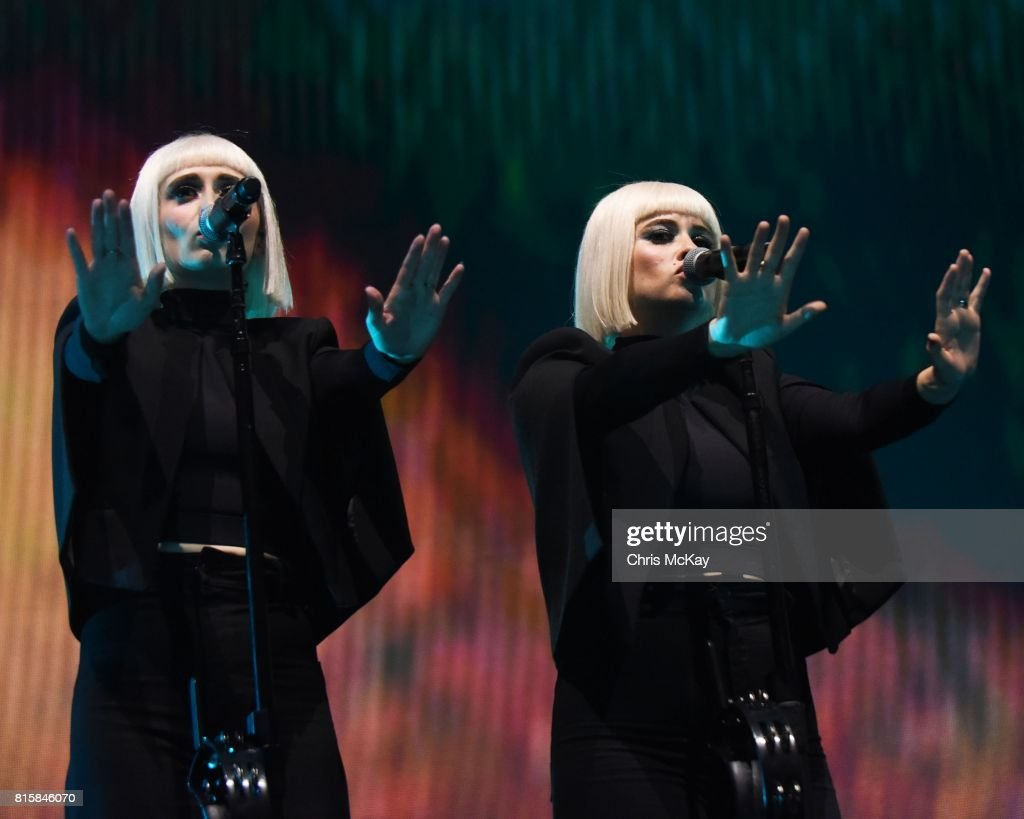 Holly Laessig and Jess Wolfe of Lucius perform during the Us + Them Tour at Infinite Energy Center on July 16, 2017 in Duluth, Georgia.