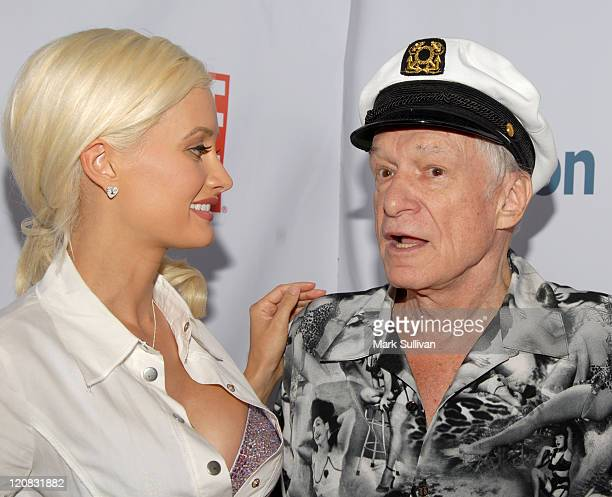 Holly Madison and Hugh Hefner during The Girls Next Door by Holly Madison Jewelry Collection Unveiled at Kitson in Los Angeles California United...
