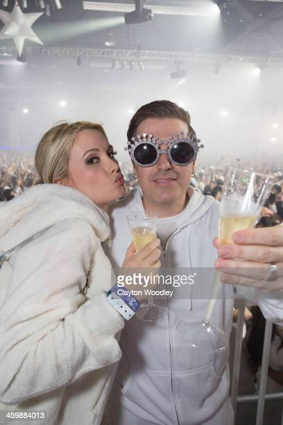 Holly Madison and Pasquale Rotella attend the White Wonderland New Year's Eve Gala 2013 Presented By Insomniac Events at Anaheim Convention Center on...