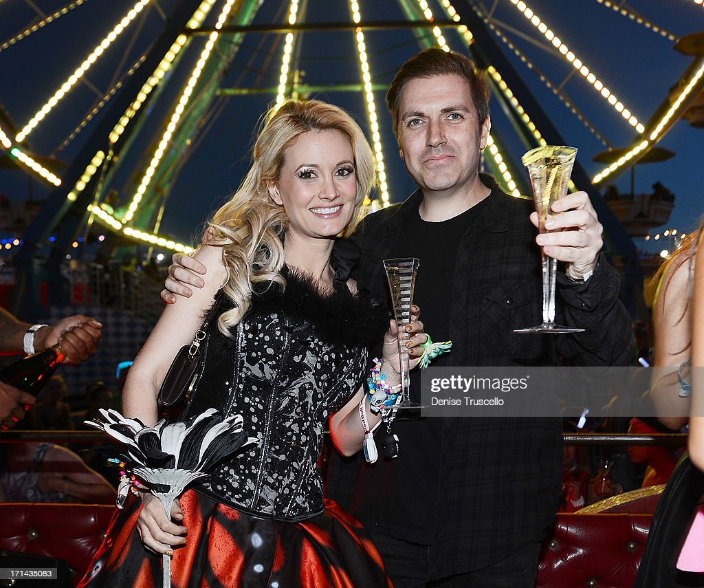 <a gi-track='captionPersonalityLinkClicked' href=/galleries/search?phrase=Holly+Madison&family=editorial&specificpeople=227275 ng-click='$event.stopPropagation()'>Holly Madison</a> and Pasquale Rotella pose for photos in front of the Ferris wheel where he asked for her hand in marriage during the 17th annual Electric Daisy Carnival at Las Vegas Motor Speedway on June 23, 2013 in Las Vegas, Nevada.
