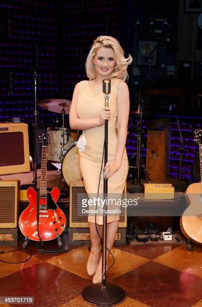 Holly Madison poses for photos after her guest appearance at Harrah's Las Vegas on December 4 2013 in Las Vegas Nevada