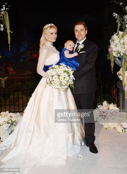 Holly Madison Rainbow Rotella and Pasquale Rotella pose for photos after Holly and Pasquale's wedding ceremony at Disneyland on September 10 2013 in...