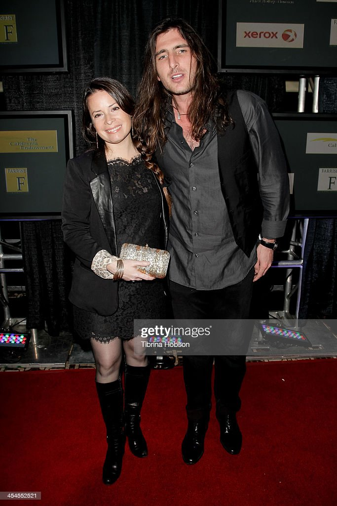 <a gi-track='captionPersonalityLinkClicked' href=/galleries/search?phrase=Holly+Marie+Combs&family=editorial&specificpeople=213928 ng-click='$event.stopPropagation()'>Holly Marie Combs</a> and Josh Cocktail attend the CNN 's 'A New Way of Life Reentry Project' 15th annual fundraising gala at Omni Los Angeles Hotel on December 8, 2013 in Los Angeles, California.