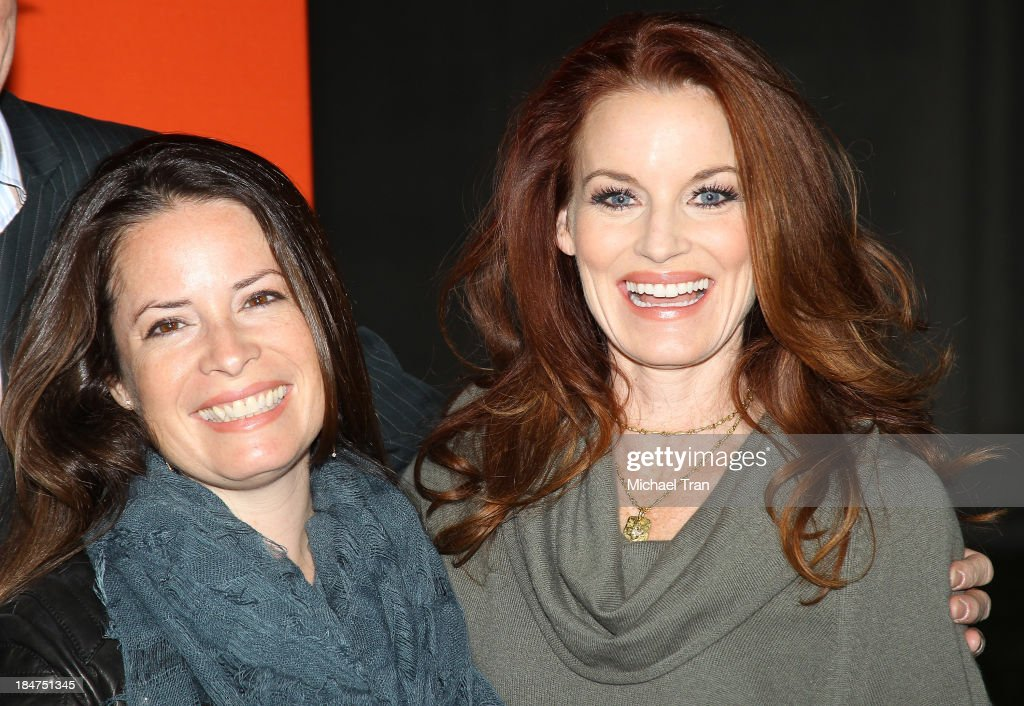 <a gi-track='captionPersonalityLinkClicked' href=/galleries/search?phrase=Holly+Marie+Combs&family=editorial&specificpeople=213928 ng-click='$event.stopPropagation()'>Holly Marie Combs</a> (L) and <a gi-track='captionPersonalityLinkClicked' href=/galleries/search?phrase=Laura+Leighton&family=editorial&specificpeople=228022 ng-click='$event.stopPropagation()'>Laura Leighton</a> arrive at the 'Pretty Little Liars' celebrates Halloween episode held at Hollywood Forever on October 15, 2013 in Hollywood, California.