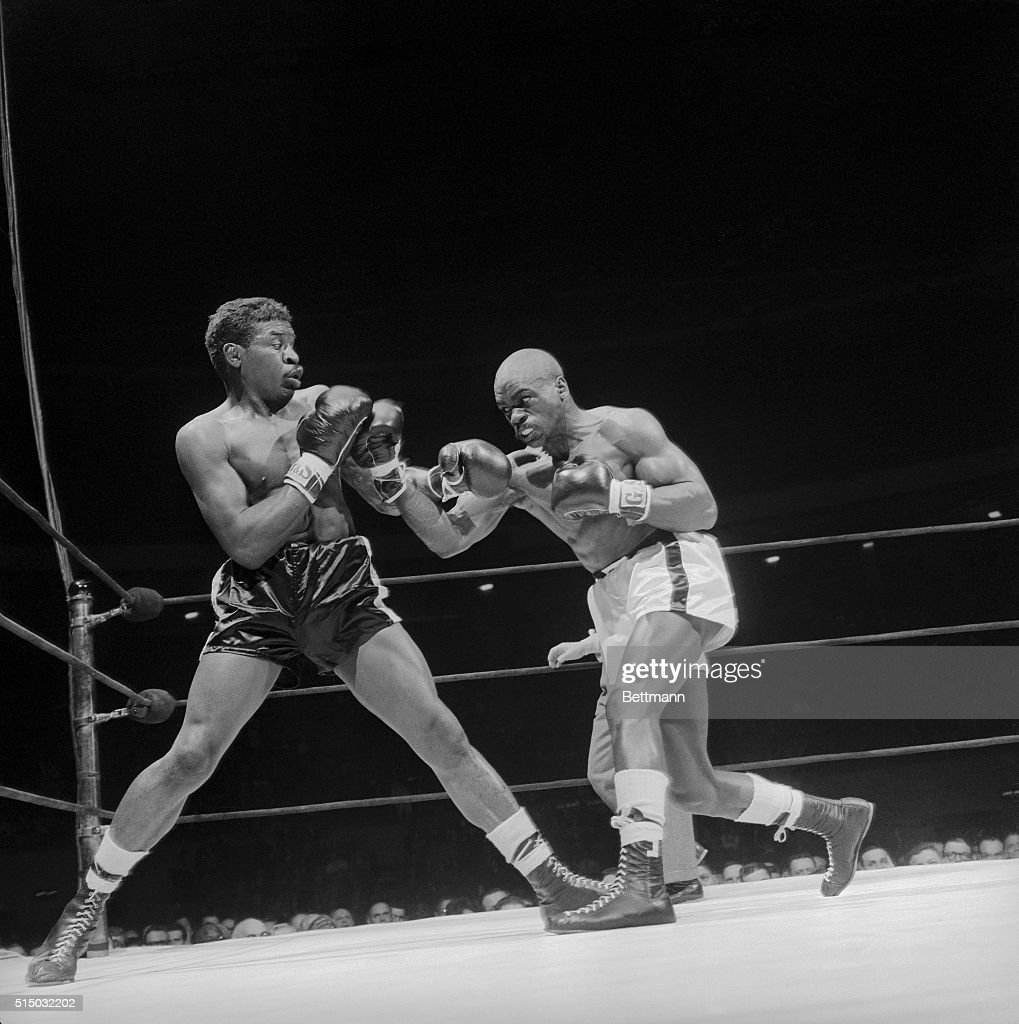 Holly Mims recoils from fury of middleweight contender Rubin Carter during their bout at Madison Square Garden Carter won a unanimous decision over...