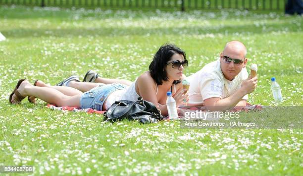 Holly Raven and Ken Forbes enjoy an ice cream during the sunny bank holiday weather in Dean's Park York