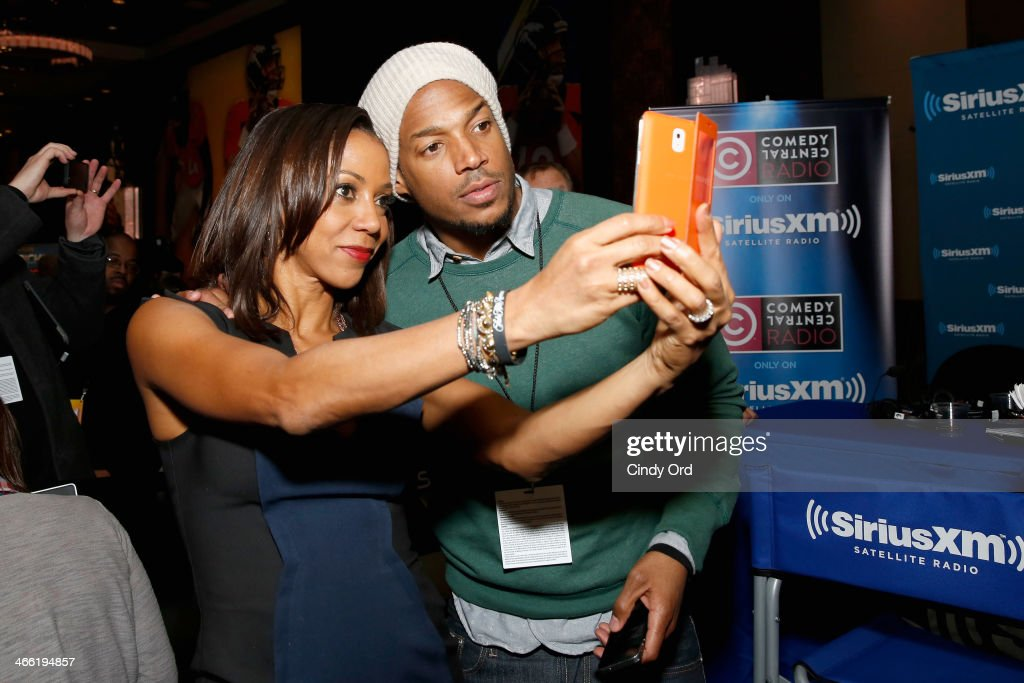 Holly Robinson Peete (L) and comedian Marlon Wayans attend SiriusXM at Super Bowl XLVIII Radio Row on January 31, 2014 in New York City.