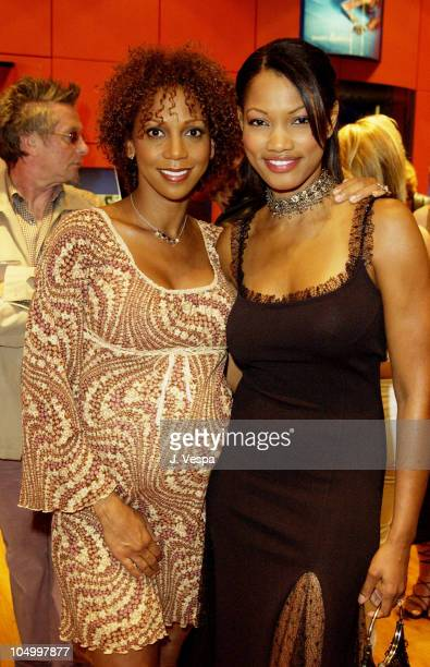 Holly Robinson Peete and Garcelle Beauvais during Vogue Takes Beverly Hills Daniel Swarovski Party at Daniel Swarovski Store at Hollywood Highland in...