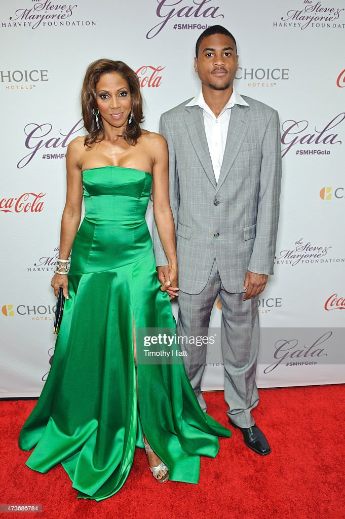 Holly Robinson Peete and son RJ attend the Steve Marjorie Harvey Foundation Gala on May 16 2015 in Chicago Illinois