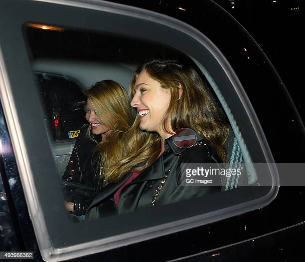 Holly Valance and Kelly Brook leave Sexy Fish restaurant in Mayfair on October 23 2015 in London England