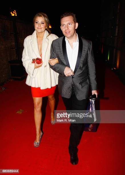Holly Valance and Nick Bank departs the 60th Birthday Celebration of Richard Desmond at Old Billingsgate Market on December 8 2011 in London England
