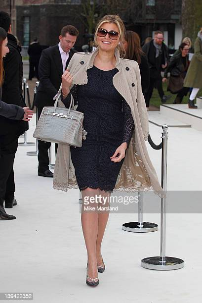 Holly Valance arrives at the Burberry Autumn/Winter 2012 show at London Fashion Week at Kensington Gardens on February 20 2012 in London England