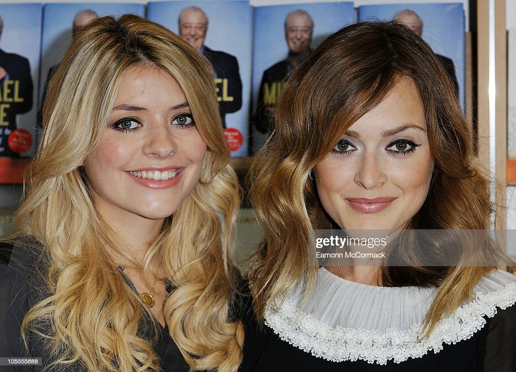 Holly Willoughby and Fearne Cotton pose for photos ahead of signing their new book The Best Friends' Guide To Life at Westfield on October 16 2010 in...