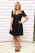 Holly Willoughby is unveiled as the new face of Oral B's 3D white toothpaste during a photocall at Superdrug Westfield Stratford City on September 7...