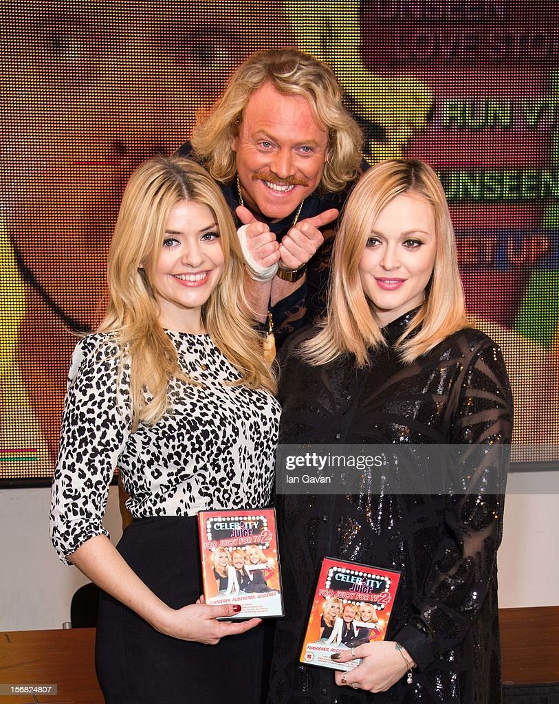 <a gi-track='captionPersonalityLinkClicked' href=/galleries/search?phrase=Holly+Willoughby&family=editorial&specificpeople=212941 ng-click='$event.stopPropagation()'>Holly Willoughby</a>, Keith Lemon and <a gi-track='captionPersonalityLinkClicked' href=/galleries/search?phrase=Fearne+Cotton&family=editorial&specificpeople=211497 ng-click='$event.stopPropagation()'>Fearne Cotton</a> attend the DVD signing for 'Celebrity Juice: Too Juicy For TV 2' at HMV, Oxford Street on November 22, 2012 in London, England.