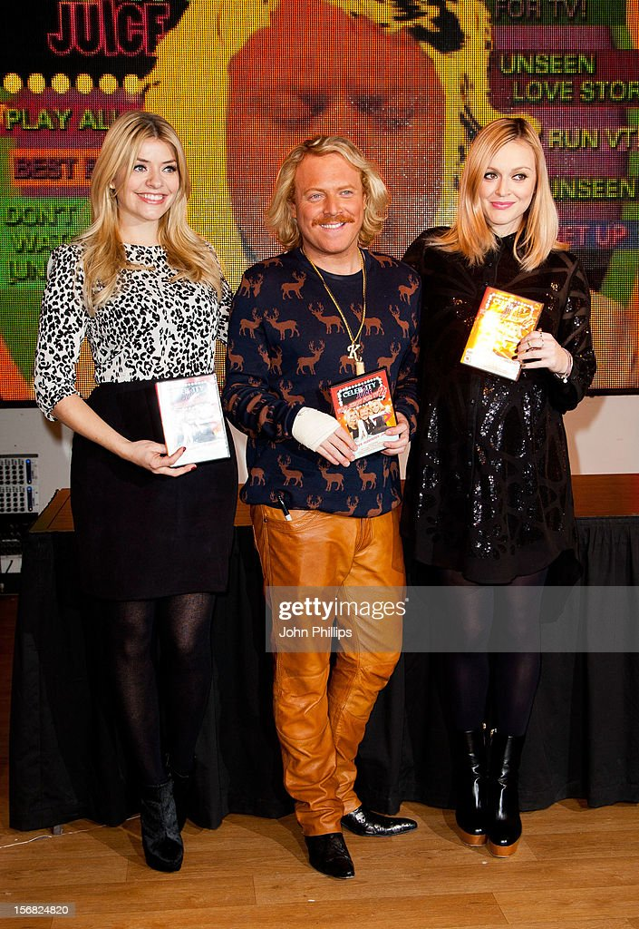 Holly Willoughby, Leigh Francis and Fearne Cotton attend the DVD signing for 'Celebrity Juice: Too Juicy For TV 2' at HMV, Oxford Street on November 22, 2012 in London, England.