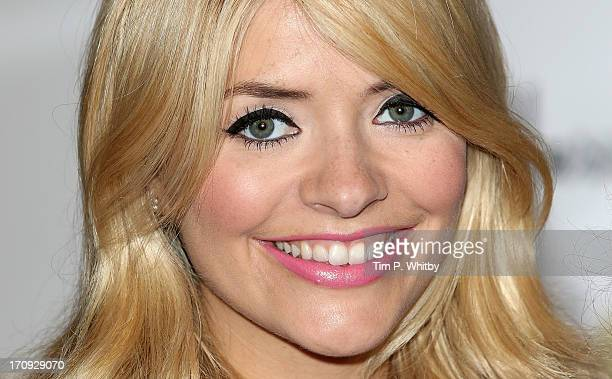 Holly Willoughby poses at a photocall ahead of signing copies of their book 'School for Stars' at Harrods on June 20 2013 in London England