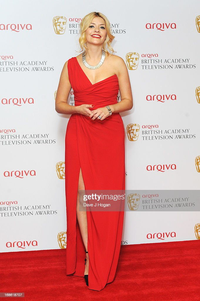 Holly Willoughby poses in front of the winners boards at the BAFTA TV Awards 2013 at The Royal Festival Hall on May 12, 2013 in London, England.