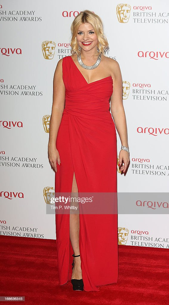 Holly Willoughby poses in the press room at the Arqiva British Academy Television Awards 2013 at the Royal Festival Hall on May 12, 2013 in London, England.