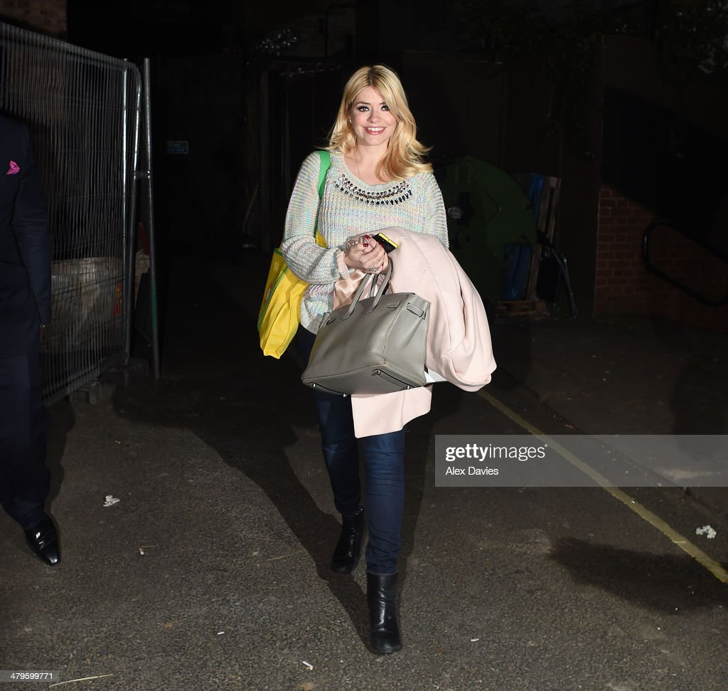 <a gi-track='captionPersonalityLinkClicked' href=/galleries/search?phrase=Holly+Willoughby&family=editorial&specificpeople=212941 ng-click='$event.stopPropagation()'>Holly Willoughby</a> seen leaving Riverside Studios after filming Celeb Juice on March 19, 2014 in London, England.