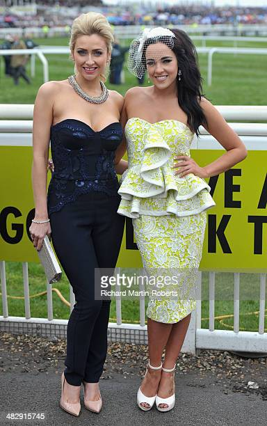 Hollyoaks Cast Members Gemma Merna and Steph Davis pose during Day 3 Grand National day of the Aintree races at Aintree Racecourse on April 5 2014 in...