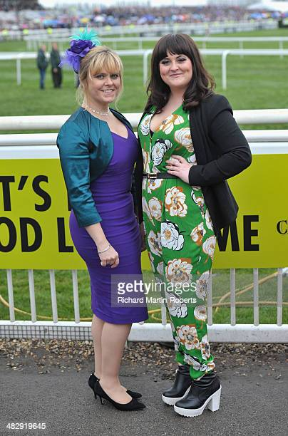 Hollyoaks Cast Members Jess Ellis and Lizzie Roper pose during Day 3 Grand National day of the Aintree races at Aintree Racecourse on April 5 2014 in...