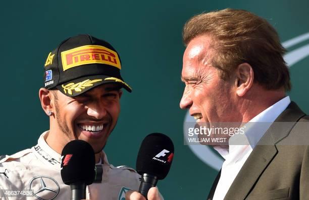 Hollywood actor Arnold Schwarzenegger interviews Mercedes AMG Petronas F1 Team's British driver Lewis Hamilton after Hamilton won the Formula One...