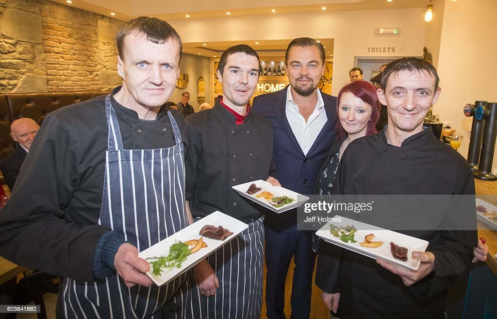 Hollywood actor Leonardo DiCaprio poses with formerly homeless staff (left to right) Colin Childs, Joe Hart, Biffy Mackay and Sonny Murray helped prepare lunch for DiCaprio and guests alongside acclaimed chef and Home co-founder Dean Gassabi (not pictured) at Social Bite restaurant, Home on November 17, 2016 in Edinburgh, Scotland. The new Edinburgh 'pay it forward' restaurant, Home, owned by Social Bite and operated by Dean Gasdsabi of Maison Bleue restaurants, was set up to provide food, training and employment opportunities for homeless people in Scotland.