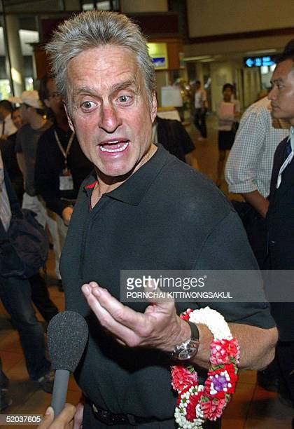 Hollywood actor Michael Douglas answers questions of the press as he arrives at the Bangkok International Airport 20 January 2005 to attend the...