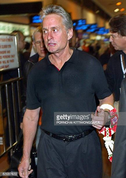 Hollywood actor Michael Douglas arrives at the Bangkok International Airport 20 January 2005 to attend the Bangkok International Film Festival The...