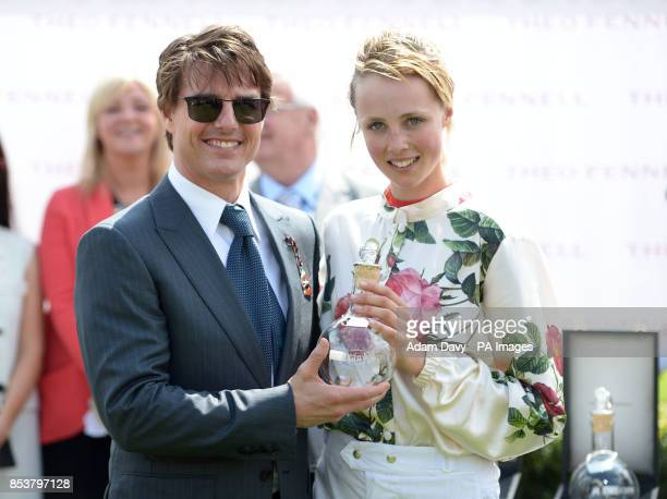 Hollywood actor Tom Cruise presents the winning trophy to Supermodel Edie Campbell after winning the Magnolia Cup The Goodwood Ladies' Race during...