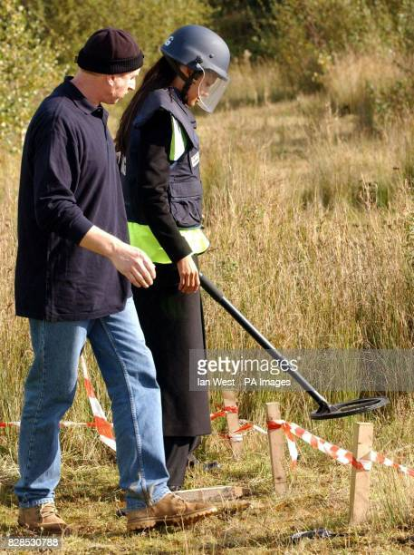 Hollywood actress and patron of the AdoptaMinefield charity Angelina Jolie is joined by technical adviser for the Mines Advisory Group Don McDonald...