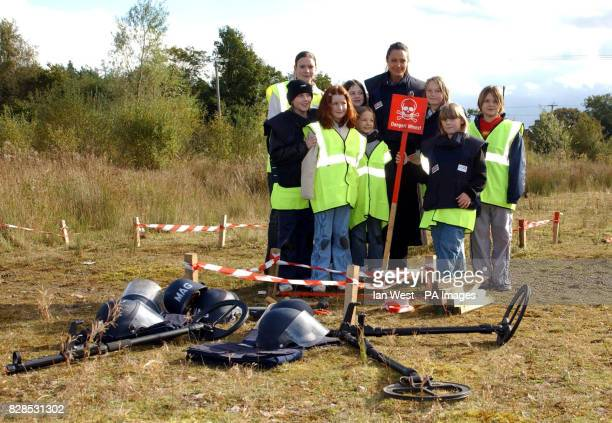 Hollywood actress and patron of the AdoptaMinefield charity Angelina Jolie is joined by pupils from Lostock Gralam County Primary School during a...