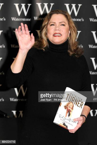 Hollywood actress Kathleen Turner holds a copy of her latest book 'Send Yourself Roses My Life' at Waterstone's Piccadilly in central London