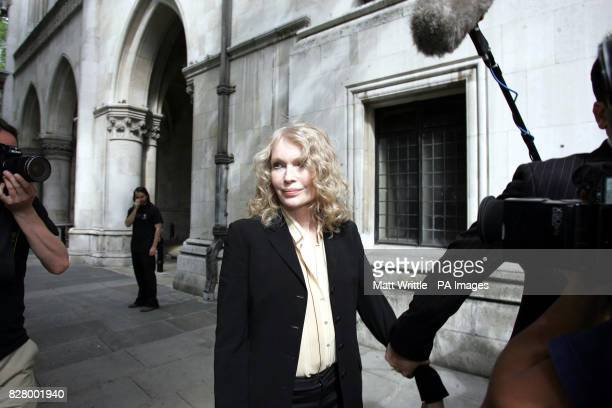 Hollywood actress Mia Farrow arrives at the Royal Courts of Justice central London She is giving evidence as film director Roman Polanski is suing...
