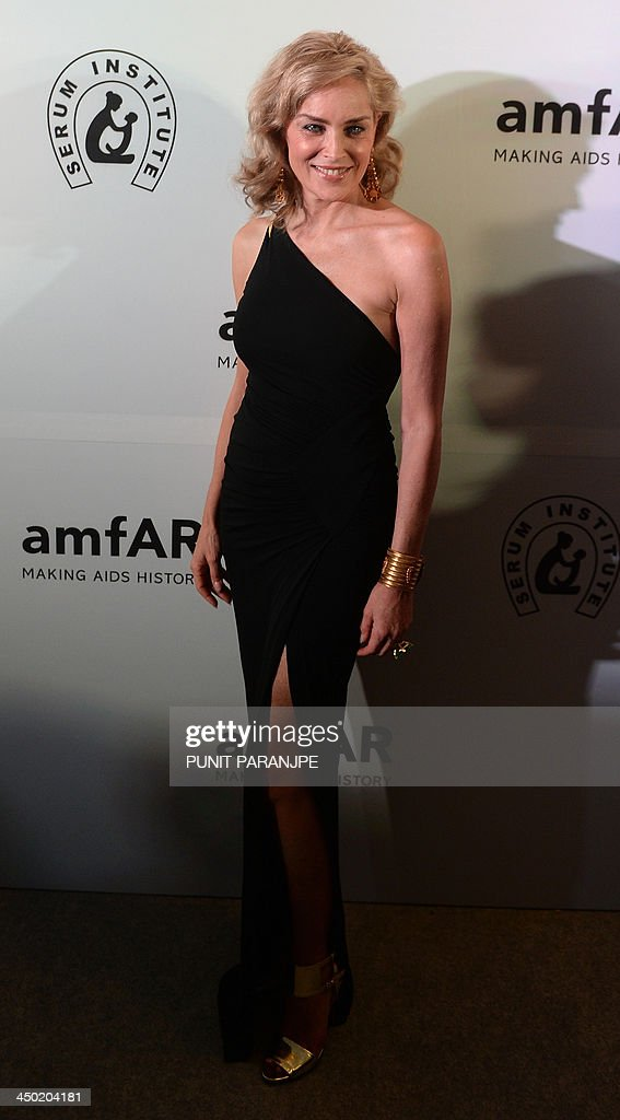 Hollywood actress Sharon Stone poses as she arrives at the Amfar India's inaugural fund raising gala in Mumbai on November 17, 2013. Amfar, The Foundation for AIDS Research, inaugural fund raising gala will be hosted by Amfars Global Fund raising Chair Sharon Stone and the India select co-chairs.