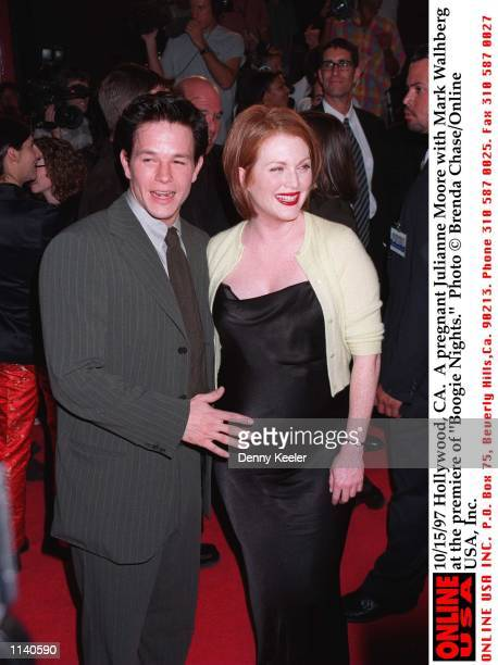 Hollywood CA A pregnant Julianne Moore with Mark Wahlberg at the premiere of 'Boogie Nights'