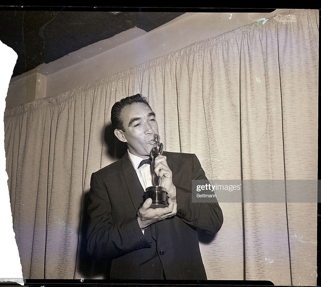 3/27/1957 Hollywood CA Actor Anthony Quinn kisses his Oscar March 27th after he was honored as 'Best Supporting Actor' for his role in 'Lust for...