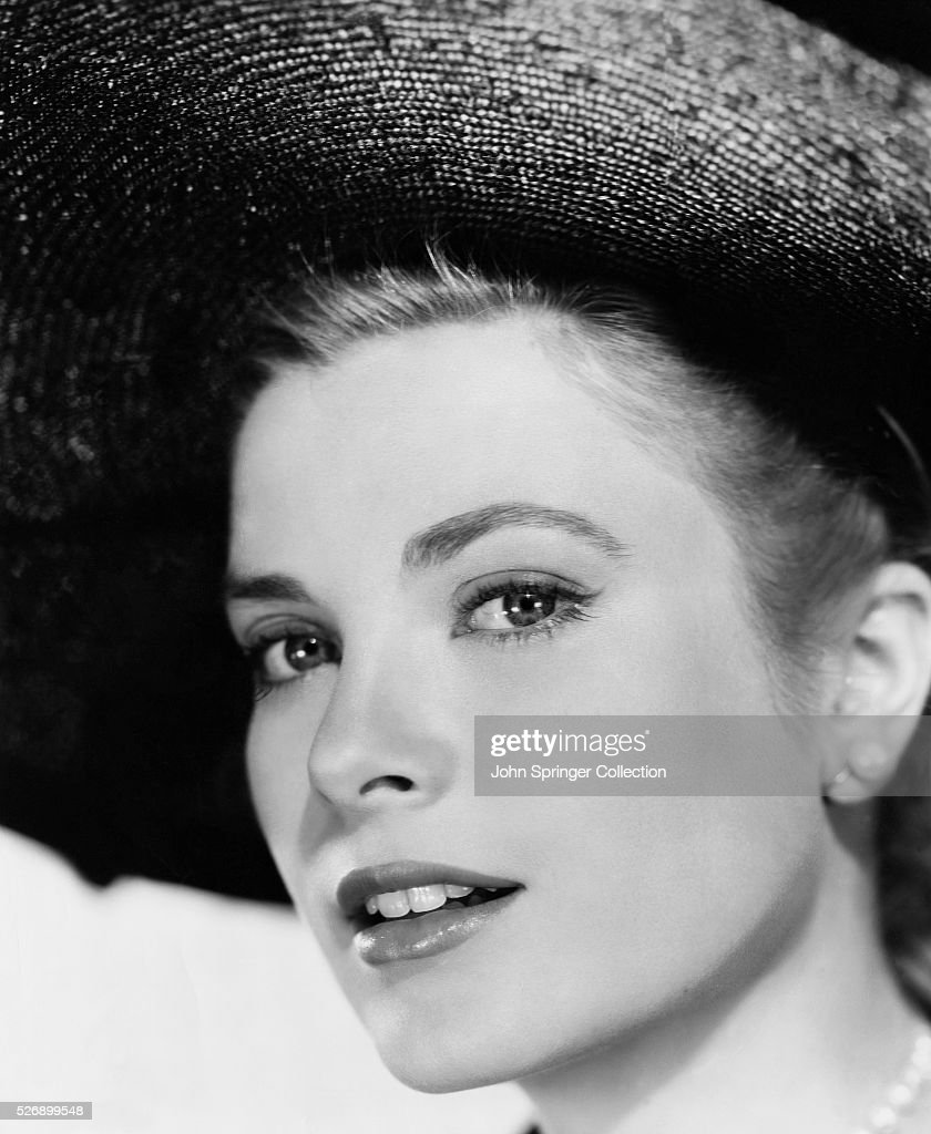 Grace Kelly, beautiful blonde American actress mostly in straight-laced leading rolls. She is shown here in a headshot wearing a hat. Undated photograph.