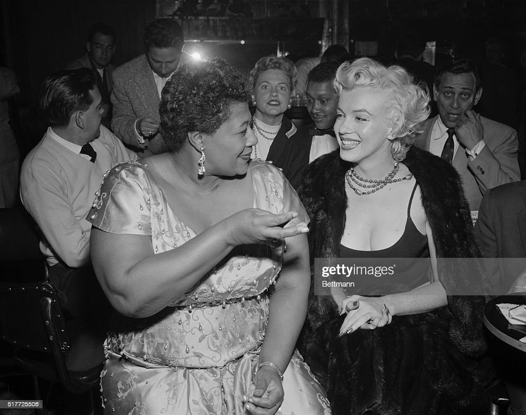 Marilyn meets Ella. Looking fit and well-groomed after her recent hospitalization, actress Marilyn Monroe (right) attends a jazz session at the Tiffany Club in Hollywood. Singer Ella Fitzgerald chats with Marilyn, who was escorted by columnist Sydney Skolsky.