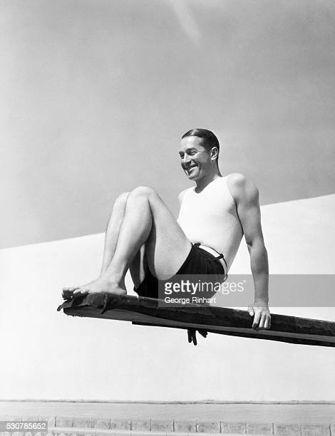 Hollywood CA Paddle Voux Francais Maurice Chevalier Paramount star of 'Love Me Tonight' snapped in the swimming pool of his Hollywood home Undated...
