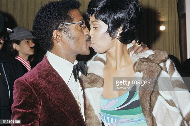 Entertainer Sammy Davis Jr and his wife attend a movie premiere of Dr Phibes at Pacific's Pantages Theater