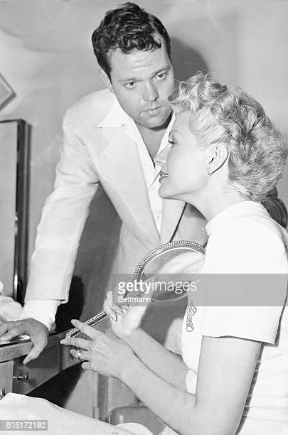 Silver Threads Among The Gold Husband Orson Welles looks at Rita Hayworth's once red hair after the actress had her tresses dyed blonde and had eight...