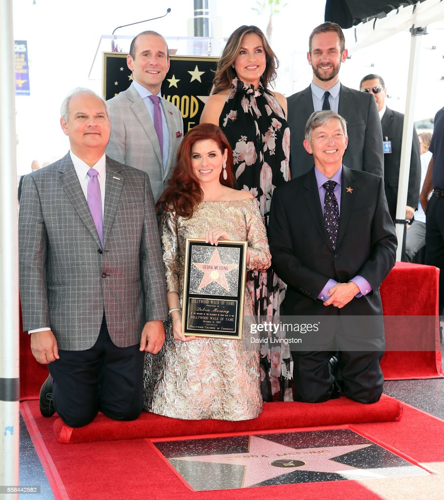 Hollywood Chamber of Commerce Chair of the Board Jeff Zarrinnam, executive producer Max Mutchnick, actresses Debra Messing and Mariska Hargitay, Councilmember Mitch O'Farrell's field deputy Dan Halden and (front) Hollywood Chamber of Commerce president and CEO Leron Gubler attend Debra Messing being honored with a Star on the Hollywood Walk of Fame on October 6, 2017 in Hollywood, California.