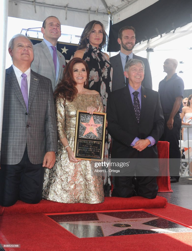 Hollywood Chamber of Commerce Chair of the Board Jeff Zarrinnam, executive producer Max Mutchnick, actresses Debra Messing and Mariska Hargitay, Councilmember Mitch O'Farrell's field deputy Dan Halden and (front) Hollywood Chamber of Commerce president and CEO Leron Gubler attend Debra Messing Star Ceremony on The Hollywood Walk Of Fame held on October 6, 2017 in Hollywood, California.